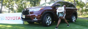"Linda ""Wellness Warrior"" Wells does a yoga pose with the Toyota Highlander"