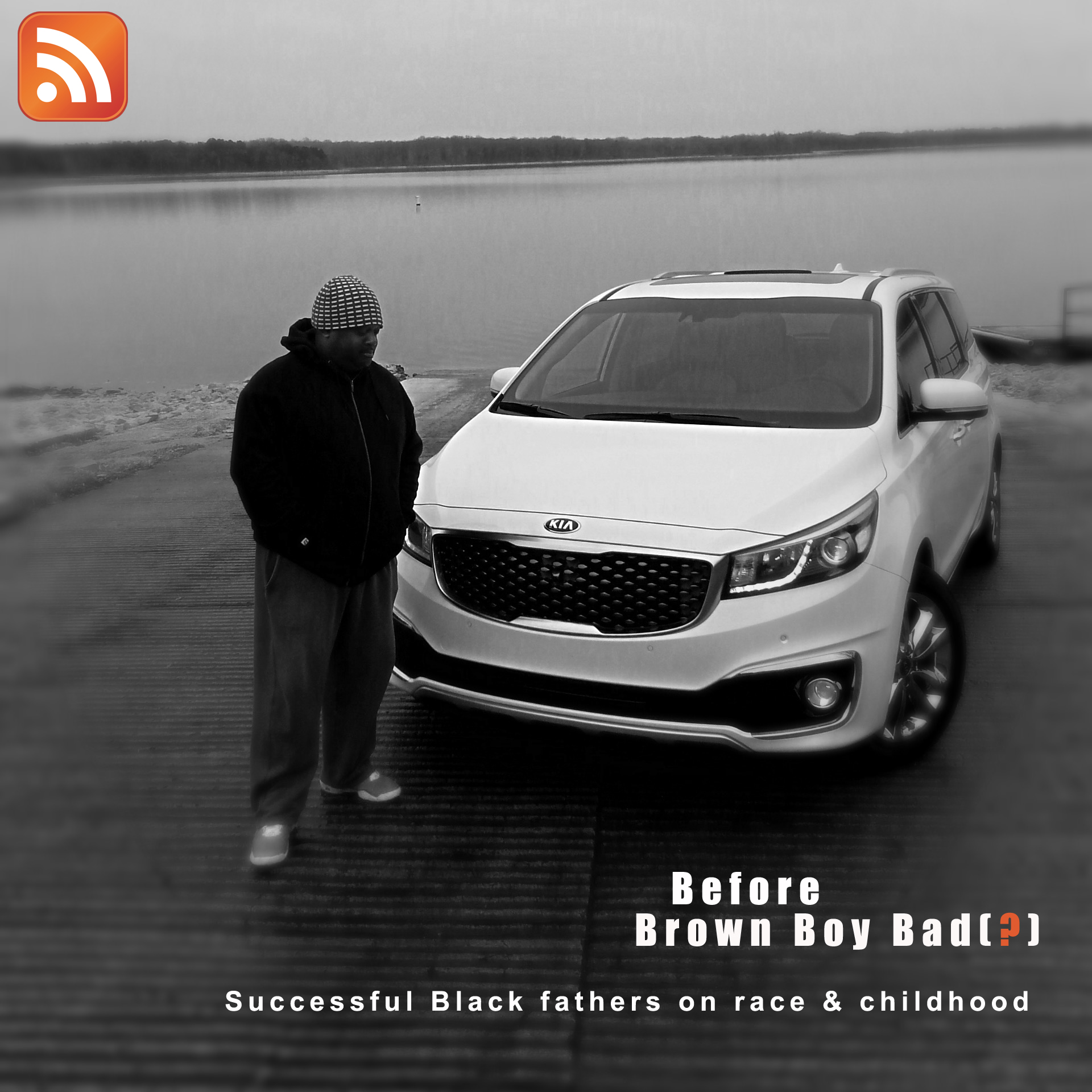 Black and white photo. An African-American man wearing a dark hoodie stands with his head bowed. Behind him a shiny white Kia Sedona minivan is parked facing him in front of a lake. The text reads: Before Brown Boy Bad(?); Successful fathers on race & childhood. Note: the question mark is orange and it is in parentheses on purpose. There is an orange podcast icon in the upper left corner of the photo.