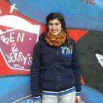 Ariel Parrella-Aureli with mural