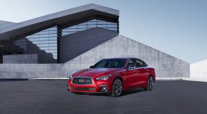 Q50 parked at a modern house